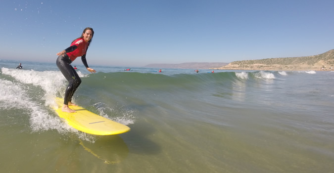 Beginner surf lessons in comfortable conditions.